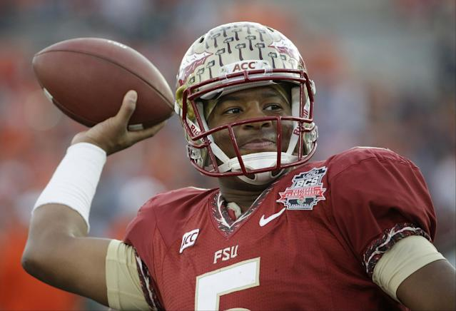 FILE - This Jan. 6, 2014 file photo shows Florida State quarterback Jameis Winston warming up before the NCAA BCS National Championship college football game against Auburn in Pasadena, Calif. The attorney for a woman who accused Winston of sexual assault says she will sue the school, the Tallahassee Police Department and the player himself, Thursday, Jan. 9, 2014. (AP Photo/David J. Phillip, file)
