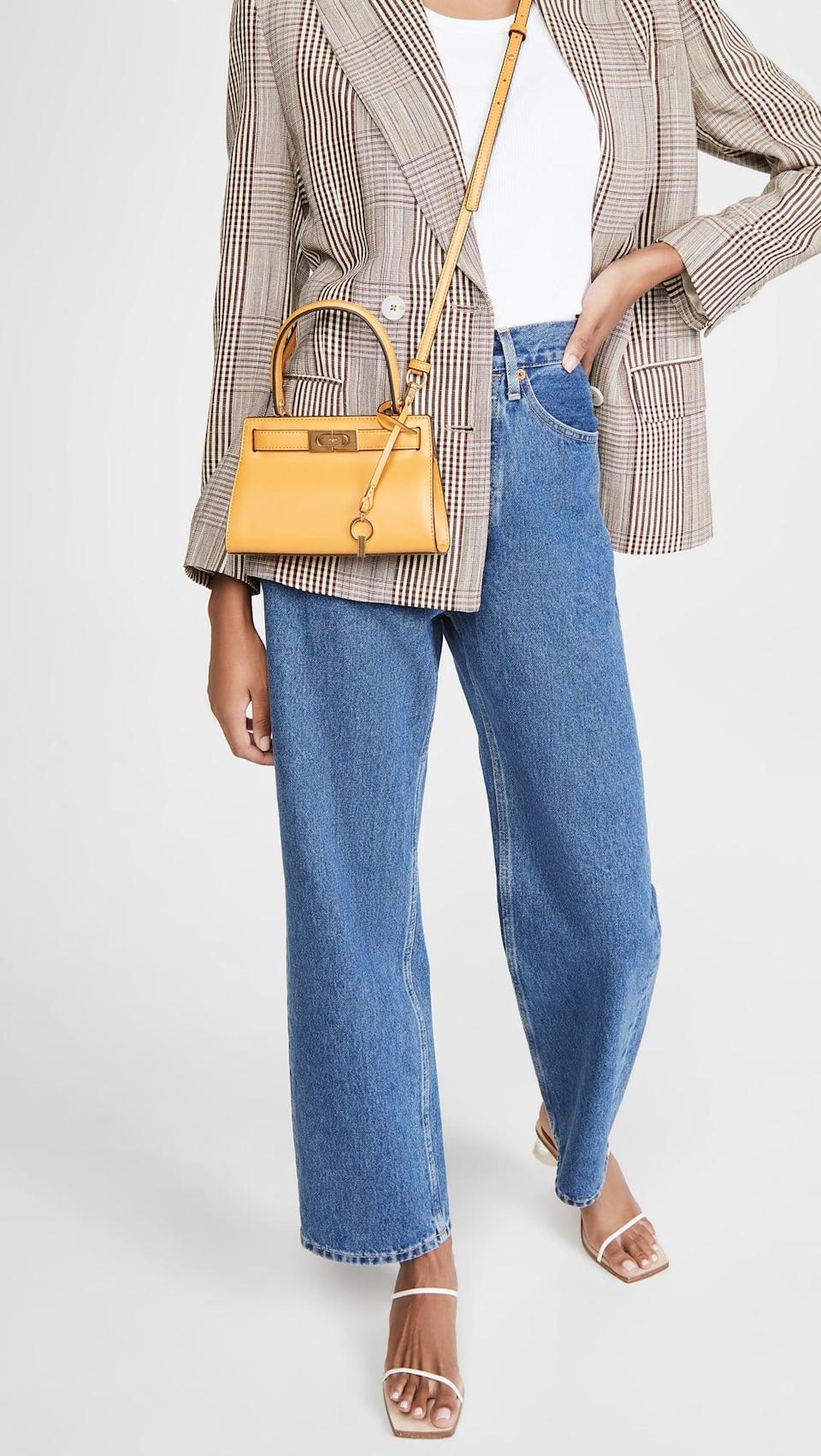 <p>Add a pop of color to your look with the <span>Tory Burch Lee Radziwill Petite Bag</span> ($498).</p>