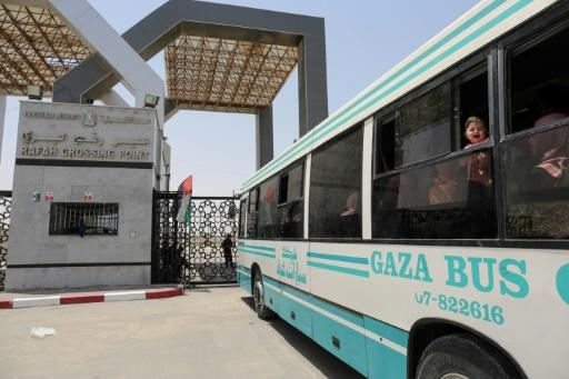 Palestinians wait to leave the Gaza Strip and enter Egypt via the Rafah border crossing on May 18, 2018