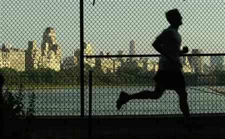MAN JOGS ON RESAVOIR PATH IN NEW YORK'S CENTRAL PARK AS PARK NEARS 150TH ANNIVERSAY.