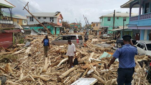 <p>View of damage caused the day before by Hurricane Maria in Roseau, Dominica, on Sept. 20, 2017. (STR/AFP/Getty Images) </p>