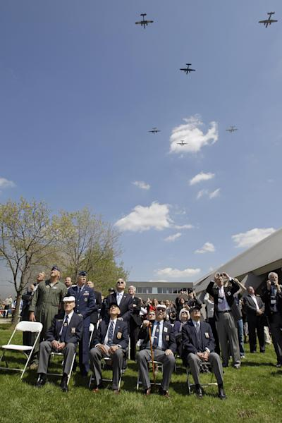 Three surviving members of the Doolittle Raiders, front row from left: David J. Thatcher, Richard E. Cole and Edward J. Saylor, join historian Carroll V. Glines, far right, in watching a flyover of B-25 bombers at the National Museum of the United States Air Force in Dayton, Ohio commemorating the 70th anniversary of the Doolittle raid on Tokyo Wednesday, April 18, 2012. (AP Photo/Mark Duncan)
