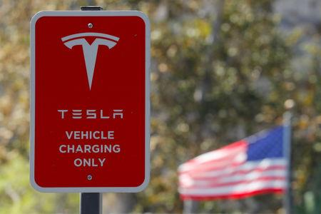 FILE PHOTO:  A parking sign is shown at a newly installed Tesla Super Charging station in Carlsbad, California