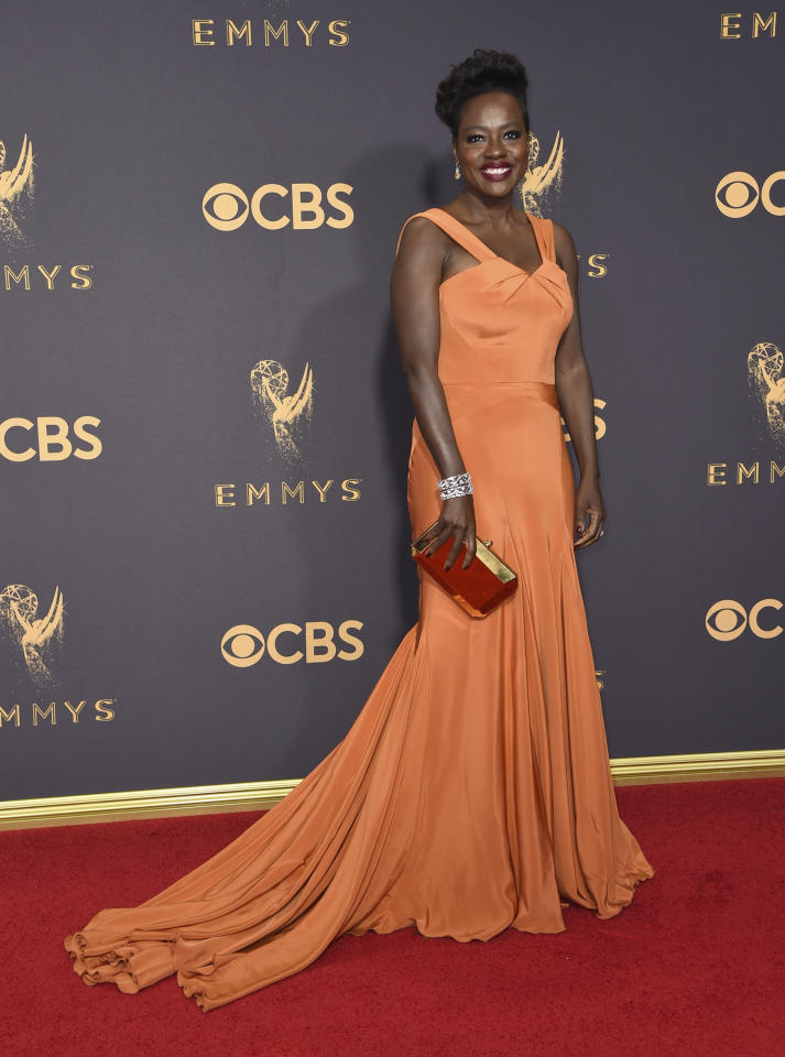 <p>Zac Posen also dressed 52-year-old Viola in a pleated burnt orange design.<br /><i>[Photo: AP]</i> </p>