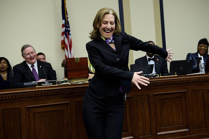 US Representative-elect Kim Schrier (D-WA) does the flossing dance before drawing a number during an office lottery for new members of Congress on Capitol Hill November 30, 2018 in Washington, DC: BRENDAN SMIALOWSKI/AFP via Getty Images