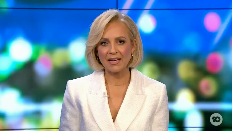 Carrie Bickmore in a white suit on The Project