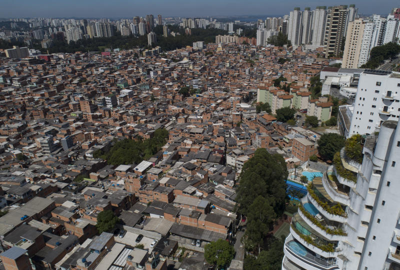 An aerial view of the Paraisopolis slum alongside the wealthy Morumbi neighborhood in Sao Paulo, Brazil, Monday, April 6, 2020. The first COVID-19 case in Sao Paulo was a 61-year-old man diagnosed in late February who had been in the hard-hit region of Lombardy, Italy. He was treated at one of the city's best hospitals in the upscale neighborhood. (AP Photo/Andre Penner)