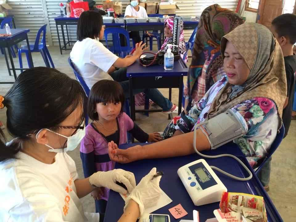 An Ops Harapan volunteer pharmacist checks a woman's blood pressure. — Picture courtesy of Ops Harapan