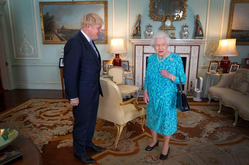 Britain's Queen Elizabeth II welcomes newly elected leader of the Conservative party, Boris Johnson during an audience in Buckingham Palace, London on July 24, 2019, where she invited him to become Prime Minister and form a new government. - Boris Johnson took over as Britain's prime minister Wednesday, promising to pull his country out of the European Union on October 31 by any means necessary. (Photo by Victoria Jones / POOL / AFP) (Photo credit should read VICTORIA JONES/AFP via Getty Images)