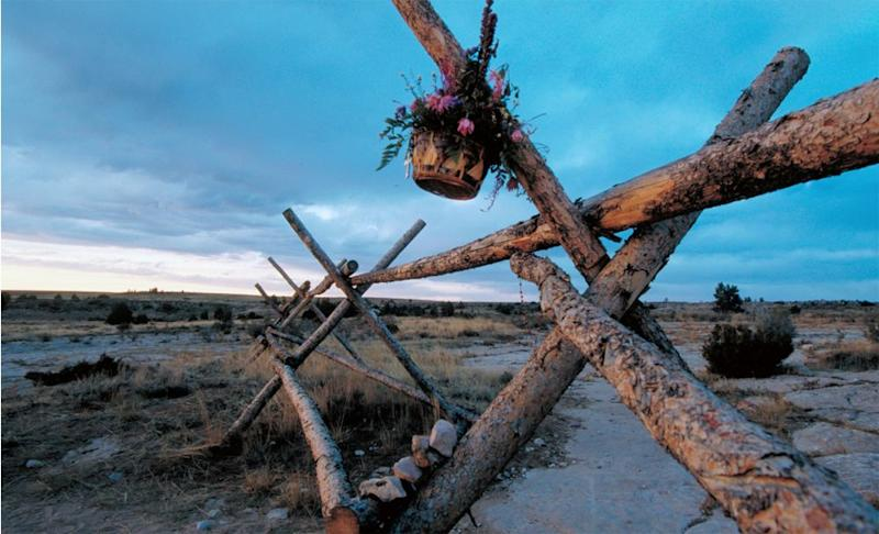 Flowers hang from the fence where Matthew Shepard was left tied and beaten in Wyoming in 1998