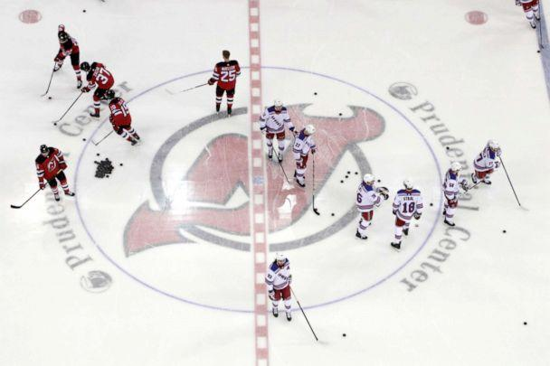 PHOTO: In this April 1, 2019, file photo, New Jersey Devils, left, and New York Rangers warm up for an NHL hockey game in Newark, N.J. (Julio Cortez/AP)