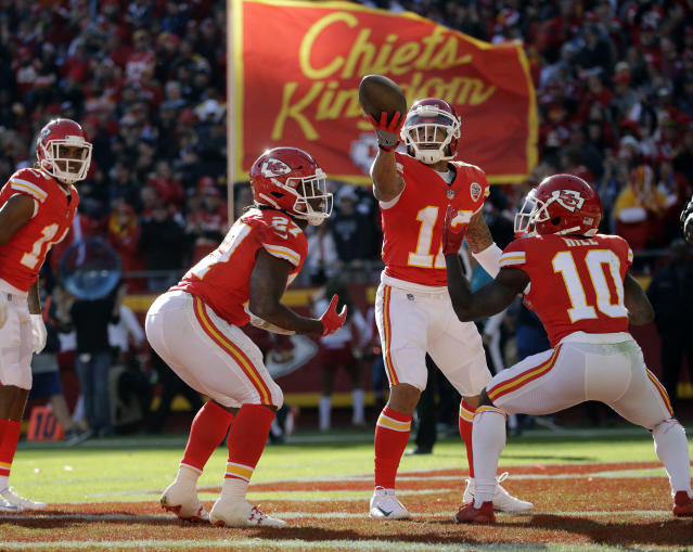 <p>Kansas City Chiefs running back Kareem Hunt (27) celebrates his touchdown against the Oakland Raiders with teammates wide receiver Tyreek Hill (10) and wide receiver Albert Wilson (12) during the first half of an NFL football game in Kansas City, Mo., Sunday, Dec. 10, 2017. (AP Photo/Charlie Riedel) </p>