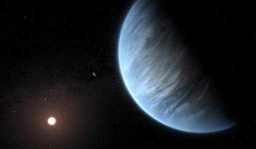 A handout artist's impression released by ESA/Hubble shows the K2-18b super-Earth