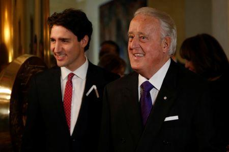 Former Canadian Prime Minister Brian Mulroney and Prime Minister Justin Trudeau arrive at a ceremony at the French embassy in Ottawa