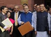 Finance Minister Arun Jaitley (C) poses as he leaves his office to present the 2015/16 federal budget in New Delhi February 28, 2015. REUTERS/Vijay Mathur