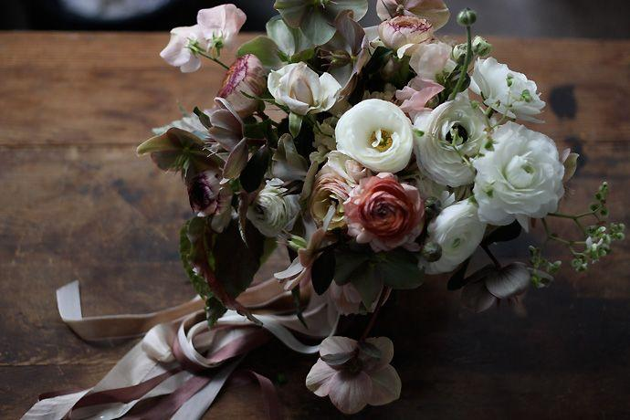 """<p>Rework bridal's most popular shade with greenery, jewel-toned reds and purples, and a more laissez-faire, wild arrangement. Florals like these are more evocative of Dutch masters paintings than holiday florals. </p><p><em>Flowers by <a href=""""http://www.nicolettecamille.com/"""" target=""""_blank"""">Nicolette Camille Floral Design</a> </em></p>"""