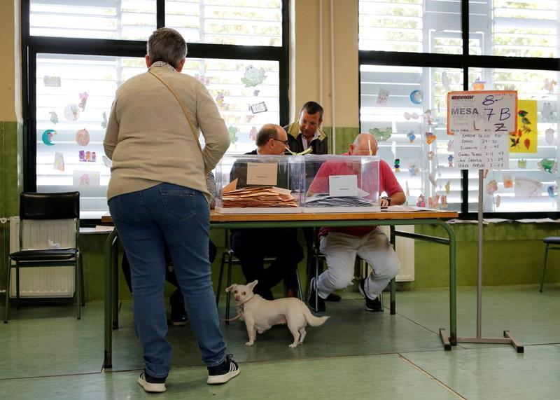 Woman votes during general election in Seville