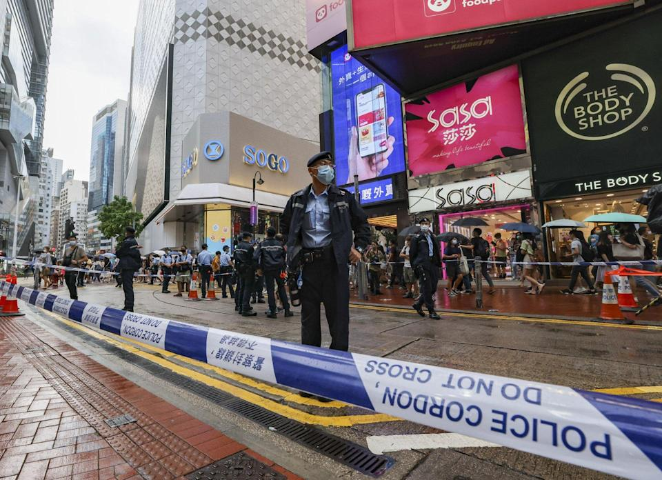 Police close off a section on East Point Road and Great George Street in Causeway Bay. Photo: Nora Tam