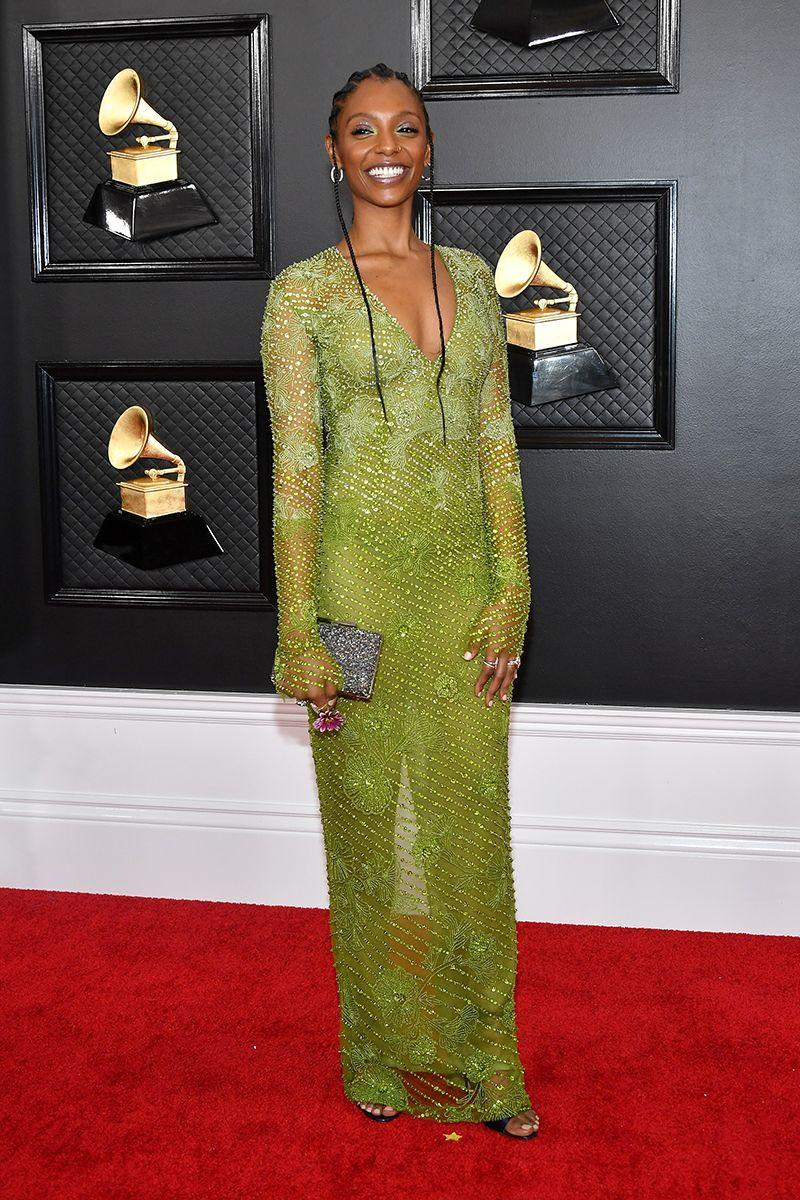 <p>Mereba gives the naked dress a fashion-forward edge by donning a style in this season's coolest tone: lime green.</p>