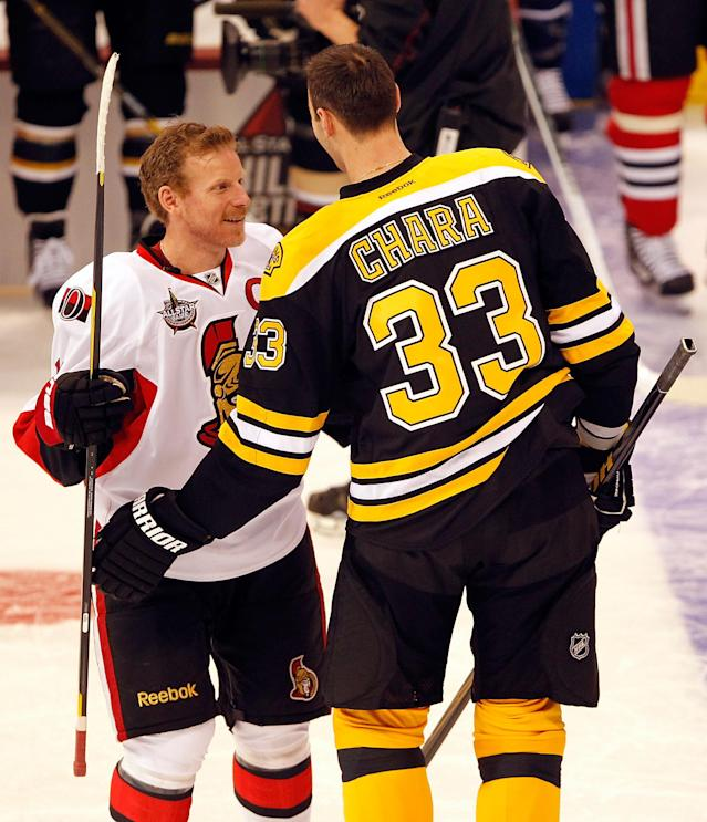 OTTAWA, ON - JANUARY 28: Zdeno Chara #33 of the Boston Bruins and Team Chara and Team Chara talks with Daniel Alfredsson #11 of the Ottawa Senators and Team Alfredsson during the Blackberry NHL Hardest Shot part of the 2012 Molson Canadian NHL All-Star Skills Competition at Scotiabank Place on January 28, 2012 in Ottawa, Ontario, Canada. (Photo by Gregory Shamus/Getty Images)