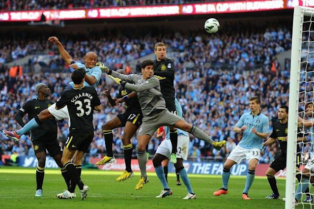 Manchester City's defender Vincent Kompany (L), Wigan's goalkeeper Joel Robles (C) and midfielder James McArthur (R) watch as the ball bobbles over the bar during the English FA Cup final at Wembley Stadium in London on May 11, 2013. Wigan won 1-0
