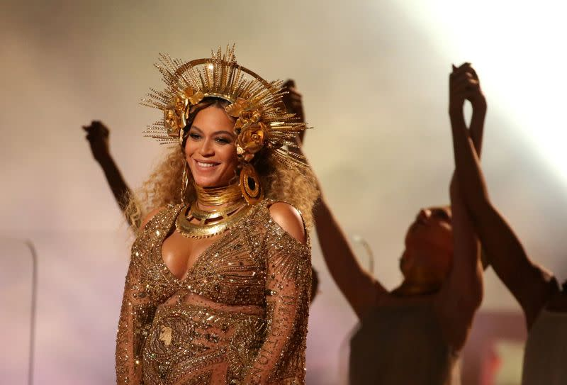 FILE PHOTO - Beyonce performs at the 59th Annual Grammy Awards in Los Angeles