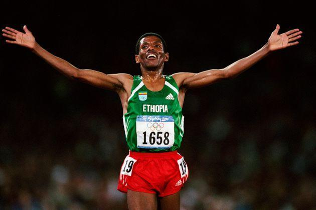 Haile Gebrselassie from Ethiopia celebrates after winning the men's 10,000-meters at the 2000 Olympics. (Photo by THIERRY ORBAN/Sygma via Getty Images) (Photo: Thierry Orban via Getty Images)
