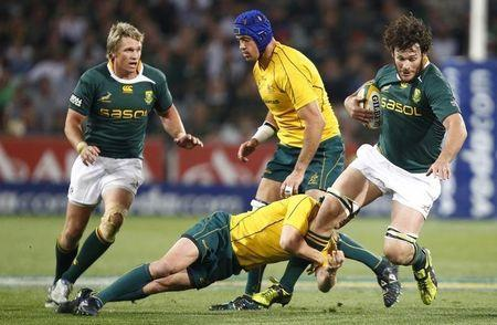 South Africa Springboks' Danie Rossouw is tackled by Australia Wallabies' Matt Giteau during their Tri-Nations rugby union game in Bloemfontein, September 4, 2010. REUTERS/Siphiwe Sibeko