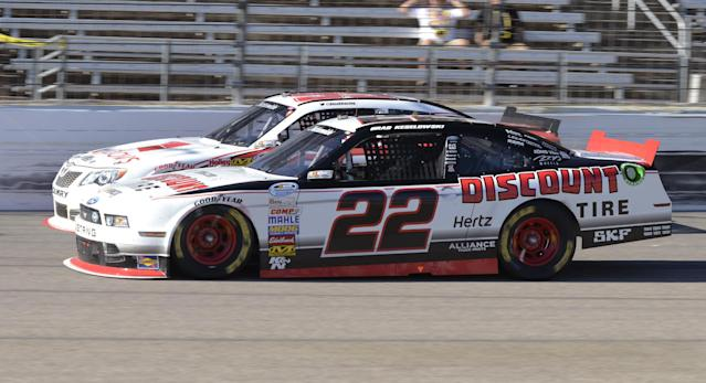 Brad Keselowski (22) races against Alex Bowman during the NASCAR Nationwide series auto race at Texas Motor Speedway in Fort Worth, Texas, Saturday, Nov. 2, 2013. (AP Photo/Larry Papke)