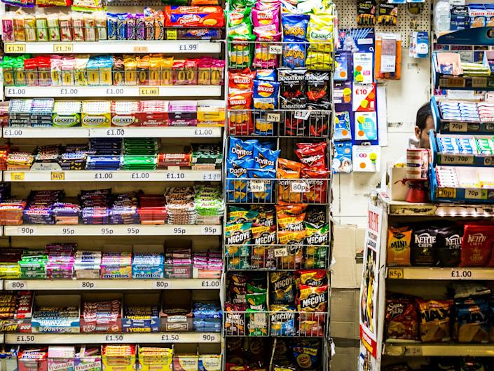 Under proposals being explored by the CMO crisps and sweets would be replaced with generic plain packaging: Getty