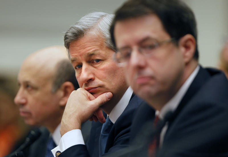 "FILE - In this Feb. 11, 2009 file photo, JPMorgan Chase & Co. Chief Executive Officer Jamie Dimon, center, flanked by Goldman Sachs & Co. Chief Executive Officer and Chairman Lloyd C. Blankfein, left, and Bank of New York Mellon Chairman Chief Executive Officer Robert Kelly, are seen on Capitol Hill in Washington during a House Financial Services Committee hearing. Dimon had to face stock analysts and reporters on Thursday, May 10, 2012, and confess to a ""flawed, complex, poorly reviewed, poorly executed and poorly monitored"" trading strategy that lost a surprise $2 billion. (AP Photo/Lawrence Jackson, File)"