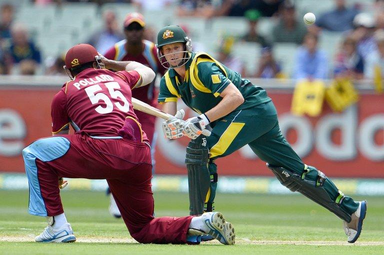 Adam Voges (R) steers a ball past West Indies fielder Kieron Pollard in the one-day international on February 10, 2013