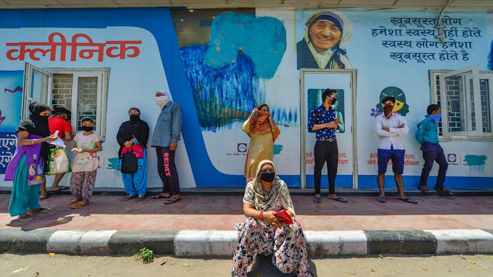 People lined up for check-up outside a clinic run by the Delhi Government during the nationwide lockdown imposed in view of the coronavirus pandemic, in New Delhi, Wednesday, 8 April 2020.