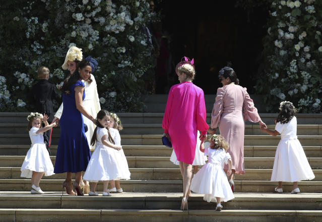 Kate, the Duchess of Cambridge, foreground left and Jessica Mulroney arrive with the bridesmaids for the wedding ceremony of Prince Harry and Meghan Markle at St. George's Chapel in Windsor Castle in Windsor, near London, England, Saturday, May 19, 2018. (Jane Barlow/pool photo via AP)