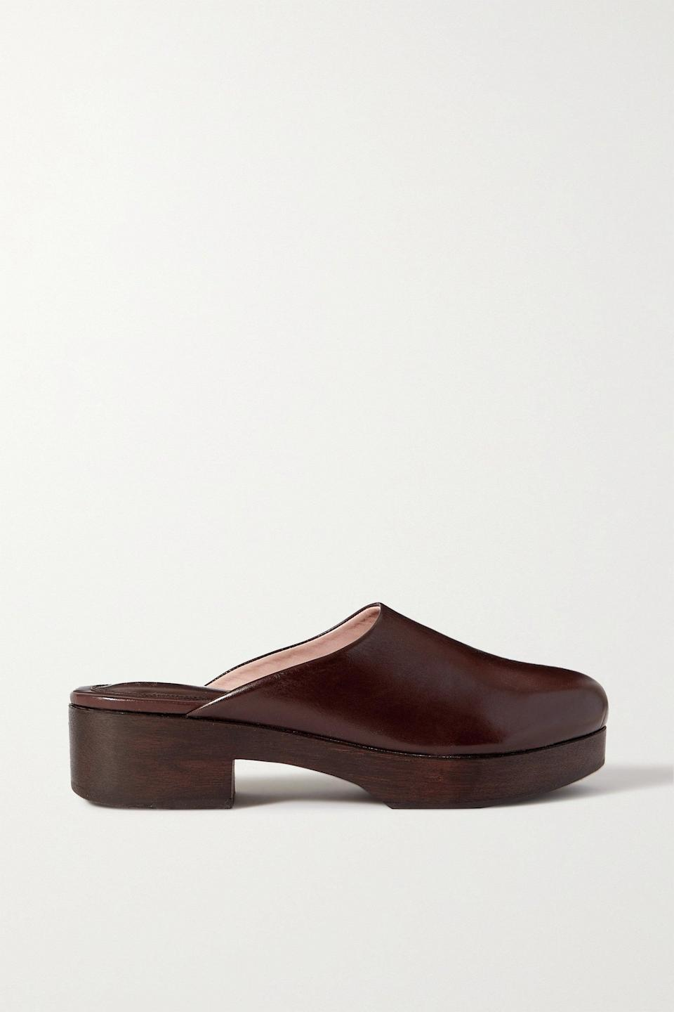 """<h2> Clogs </h2><br>""""<a href=""""https://www.refinery29.com/en-us/2020/10/10098450/womens-clogs-trend"""" rel=""""nofollow noopener"""" target=""""_blank"""" data-ylk=""""slk:The clog has made an unexpected and cool comeback"""" class=""""link rapid-noclick-resp"""">The clog has made an unexpected and cool comeback</a>, and the must-have collaboration of the season comes from The Frankie Shop x Porte and Paire. These styles are set to become a staple in every wardrobe. """"<br><br>- Libby Page, Senior Fashion Market Editor at NET-A-PORTER <br><br><strong>Porte & Paire x Frankie Shop</strong> Glossed-leather platform clogs, $, available at <a href=""""https://go.skimresources.com/?id=30283X879131&url=https%3A%2F%2Fwww.net-a-porter.com%2Fen-us%2Fshop%2Fproduct%2Fporte-paire%2Fshoes%2Fslip-ons%2Fplus-frankie-shop-glossed-leather-platform-clogs%2F11452292647421877"""" rel=""""nofollow noopener"""" target=""""_blank"""" data-ylk=""""slk:Net-A-Porter"""" class=""""link rapid-noclick-resp"""">Net-A-Porter</a>"""