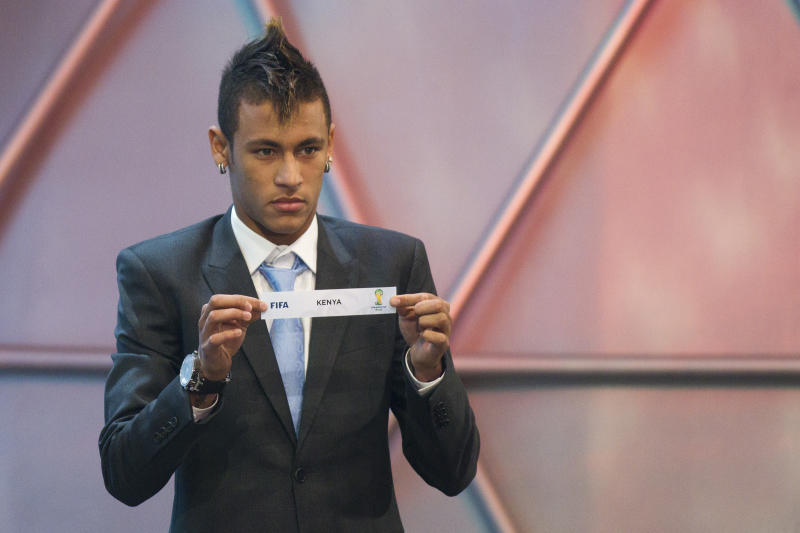Brazil's soccer player Neymar of Brazil, shows a piece of paper with the country's name Kenya during the Preliminary Draw of the 2014 FIFA World Cup Brazil in Rio de Janeiro, Brazil, Saturday July 30, 2011. The 2014 World Cup takes shape Saturday as the qualifying draw lays out each nation's path to securing a spot in the tournament in three years' time. The draw determined the layout of the qualifying groups for Africa; North, Central America and the Caribbean; Asia; Europe; and Oceania.  (AP Photo/Felipe Dana)
