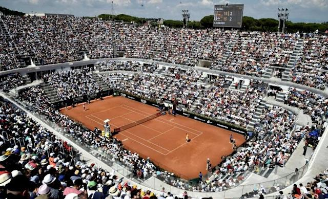 A general view of the central court shows Serbia's Novak Djokovic returning the ball to Spain's Rafael Nadal (R) during their semi final match at Rome's ATP Tennis Open tournament at the Foro Italico in Rome (AFP Photo/TIZIANA FABI)