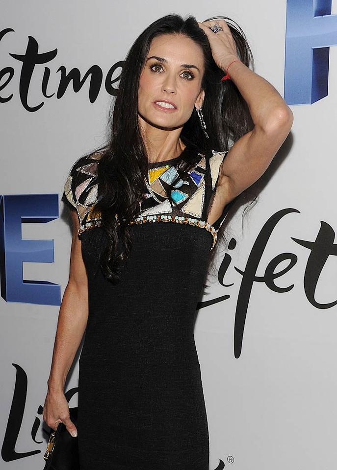 "Demi Moore has developed a serious drinking problem, trying to cope with reports of Ashton Kutcher's infidelity, says In Touch. The mag reveals Moore, who tried to ""look young and hot and keep Ashton interested,"" has now become such ""a complete mess,"" her loved ones are ""begging her to check into rehab."" For how much Moore is drinking, and what Kutcher is trying to do to help her, check out what Moore pal leaks to Gossip Cop.  Jason Kempin/WireImage.com - September 26, 2011"