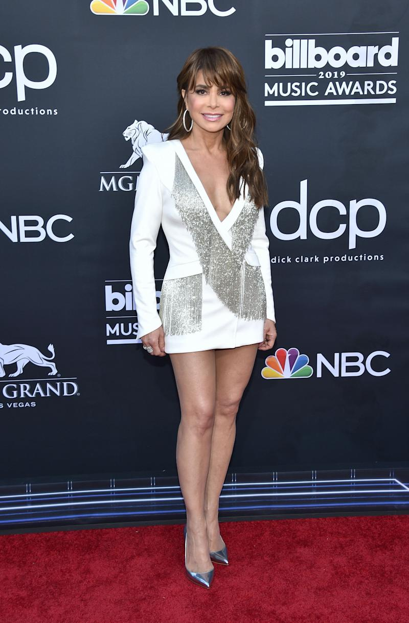 Paula Abdul, 56, wears a tiny tuxedo dress on the red carpet at the Billboard Music Awards. (Photo: Getty Images)