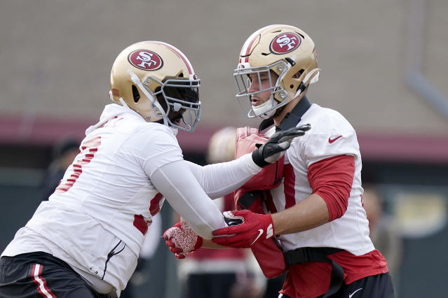 San Francisco 49ers defensive tackle Earl Mitchell, left, and defensive end Nick Bosa, right, go through drills during NFL football practice at the team's training facility in Santa Clara, Calif., Wednesday, Jan. 15, 2020. The 49ers will host the Green Bay Packers for the NFC Championship on Sunday. (AP Photo/Tony Avelar)