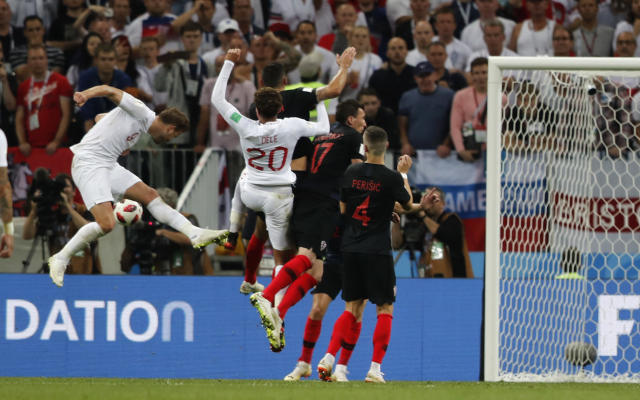 England's Harry Kane, left, fails to score during the semifinal match between Croatia and England at the 2018 soccer World Cup in the Luzhniki Stadium in Moscow, Russia, Wednesday, July 11, 2018. (AP Photo/Frank Augstein)