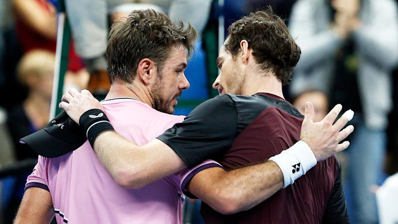 Stan Wawrinka and Andy Murray share a respectful moment after the Brit's win.