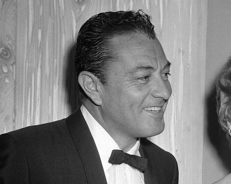 CORRECT SPELLING OF FRIARS CLUB - FILE - This Feb. 14, 1957 file photo shows singer Tony Martin at testimonial dinner given Jack Benny by the Friars Club in the Hollywood section of Los Angeles. Martin, the romantic singer who appeared in movie musicals from the 1930s to the 1950s and sustained a career in records, television and nightclubs from the Depression era into the 21st century, died of natural causes Friday, July 27, 2012, at his West Los Angeles home, his friend and accountant Beverly Scott said Monday. He was 98. (AP Photo, File)