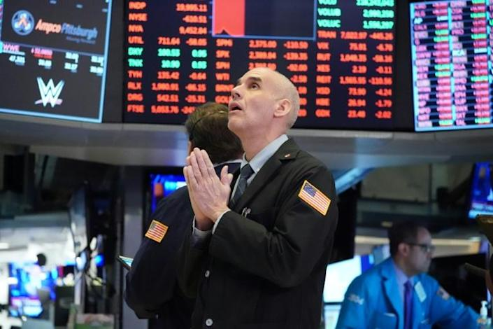 Traders work on the floor at the opening bell at the New York Stock Exchange on March 18 (AFP Photo/Bryan R. Smith)
