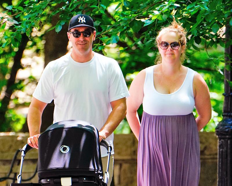 NEW YORK, NY - MAY 18: Amy Schumer and Chris Fischer take baby Gene Attell Fischer and their dog to the park on May 18, 2019 in New York City. (Photo by Gotham/GC Images)