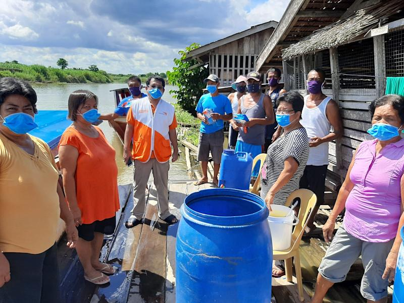 Donating protective gear in Agusan province. Photo: World Vision