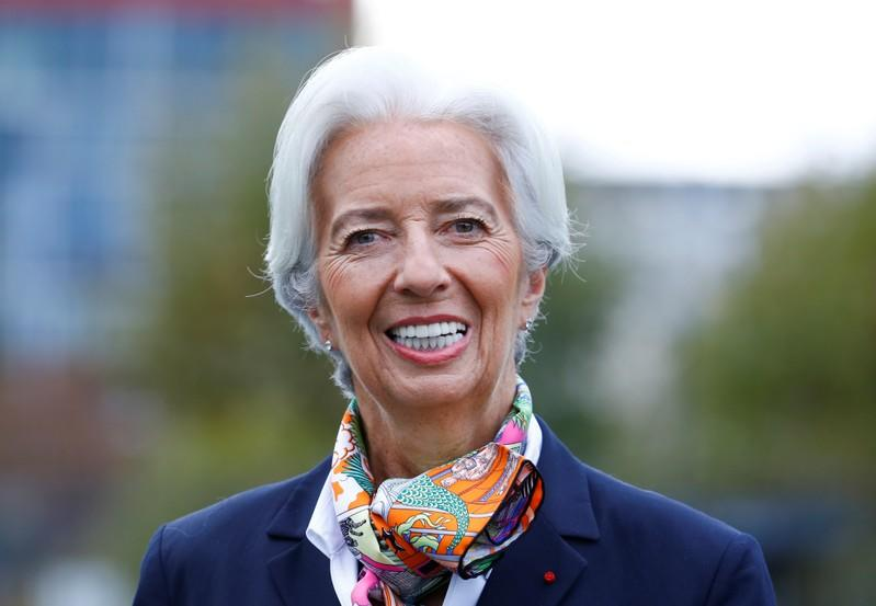 European Central Bank's President Lagarde answers journalists questions as she arrives at the ECBs headquarter in Frankfurt