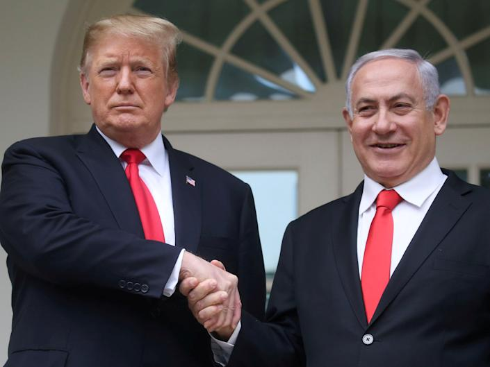 FILE PHOTO: U.S. President Donald Trump shakes hands with Israel's Prime Minister Benjamin Netanyahu as they pose on the West Wing colonnade in the Rose Garden at the White House in Washington, U.S., March 25, 2019. REUTERS/Leah Millis/File Photo