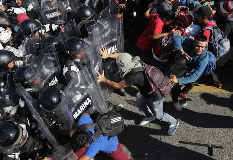 Migrants charge at members of the Mexican national guard at the border crossing between Guatemala and Mexico, near Ciudad Hidalgo.