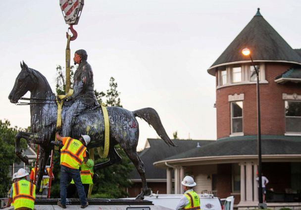 PHOTO: The John B. Castleman statue, in Louisville's Cherokee Triangle neighborhood, is removed from its pedestal where it has stood for over 100 years, in Lousville, Ky. (The Courier Journal via USA Today Network)